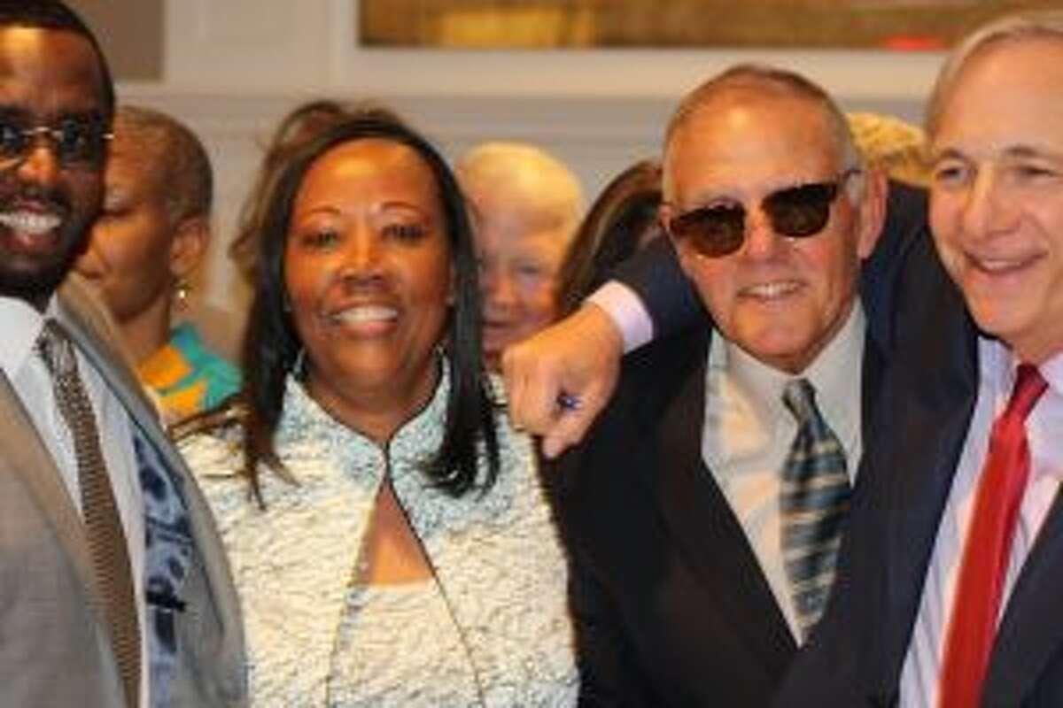 Honoree Sean Combs; Novelette Peterkin, executive director; Dick Whitcomb, Carver Board member, St. Luke's School headmaster emeritus; Ray Dalio, Bridgewater Associates. - Contributed photo