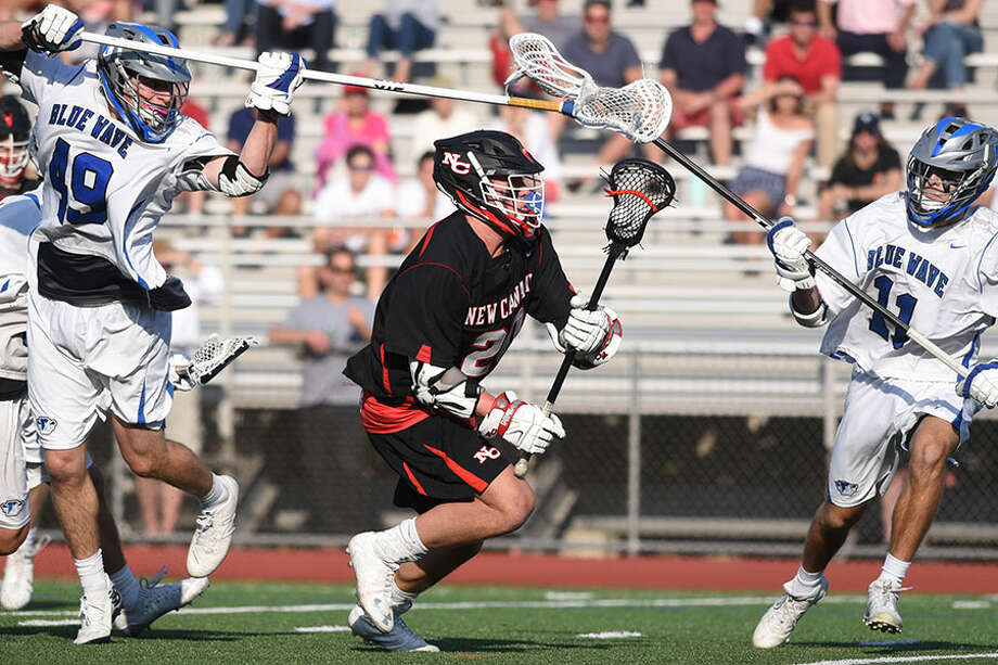 New Canaan's Quintin O'Connell in action against Darien in the FCIAC final on May 25, 2018. — Dave Stewart photo