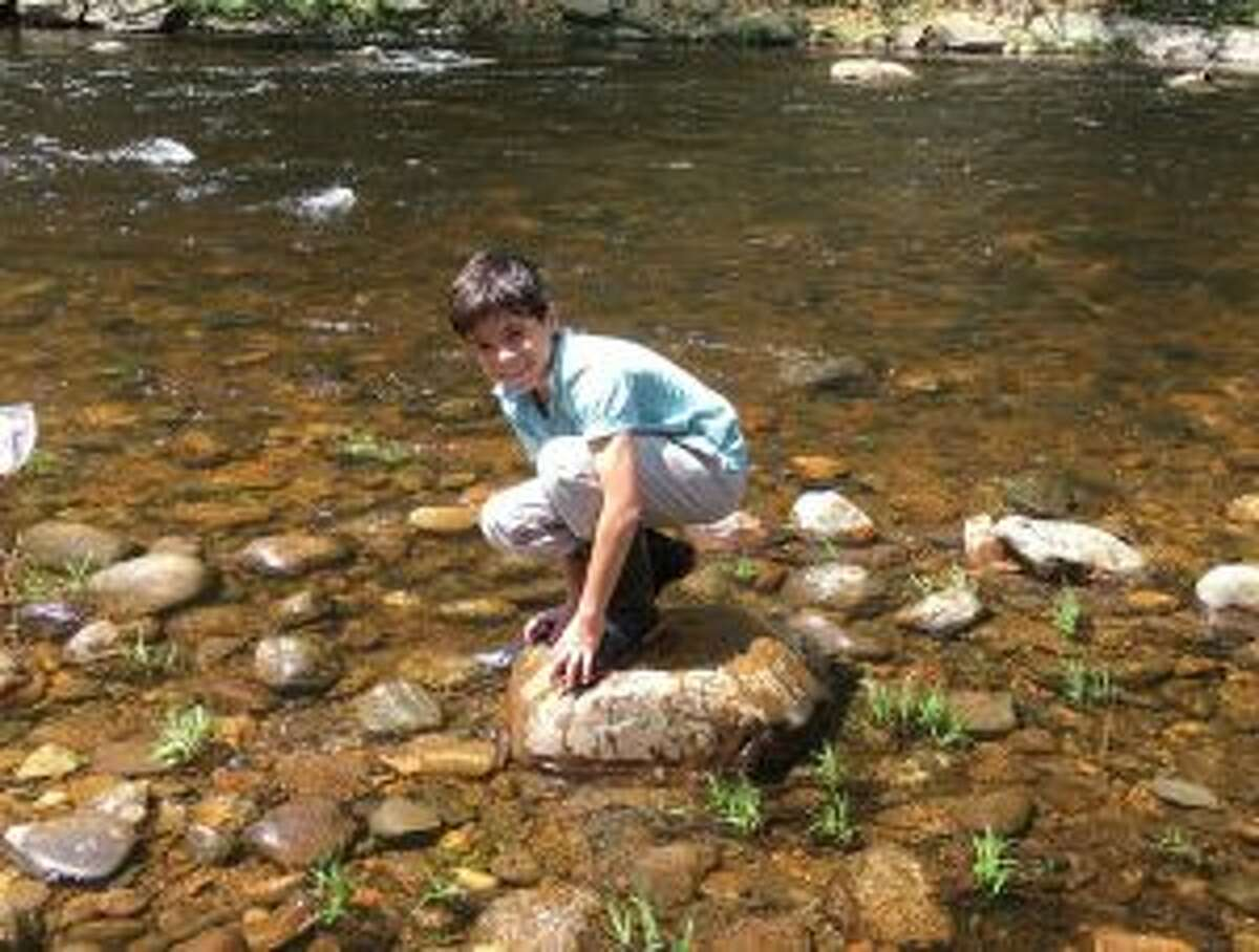 New Canaan Country School students recently stocked Salmon River. Student Ellis Frey of New Canaan. - Contributed photo