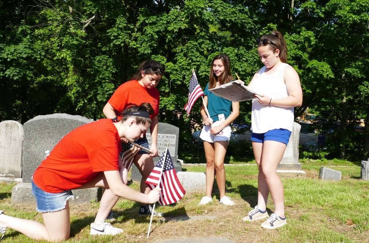 Kneeling with the flag is Kate Reeves, next to her Michelle Siegel, Celia Sokolowski, and Nora Belodeau with the chart. - Grace Duffield photo