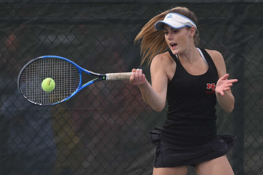 New Canaan's Ashley Walker, shown in action earlier this season, swept two sets during the Rams' 6-1 win over Trumbull in the first round of the Class L tournament on Saturday. — Dave Stewart photo