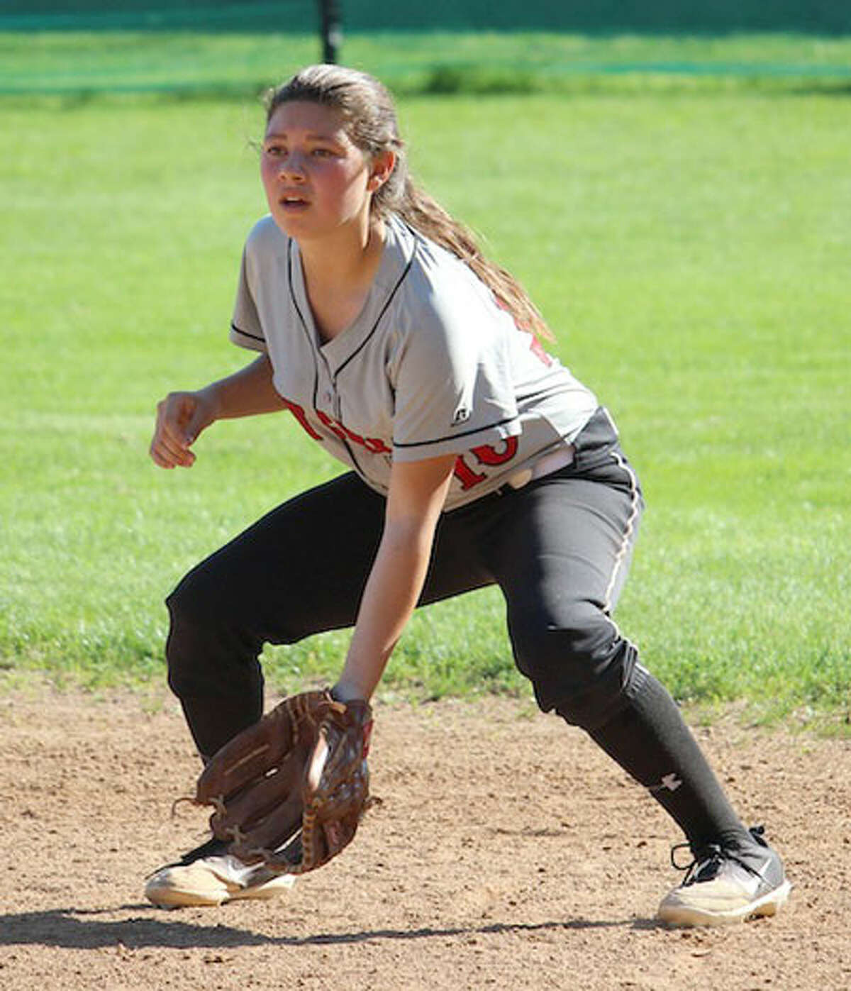New Canaan's Kaitlyn Fico stays focused on the batter. - Terry Dinan photo