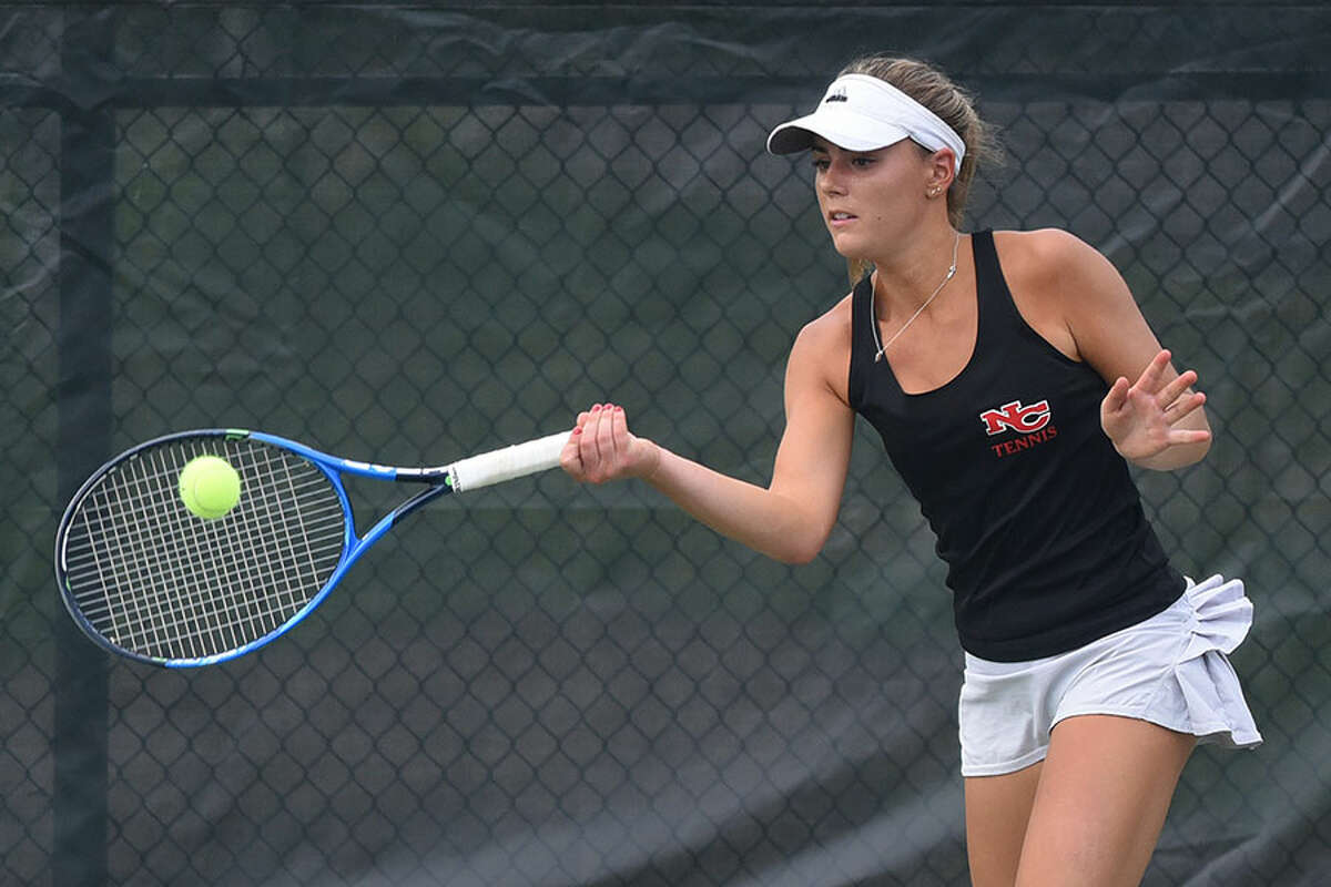 New Canaan's Ashley Walker hits a forehand shot during the FCIAC quarterfinals at NCHS last Thursday. The Rams defeated Wilton in that match, but fell to Darien in the semis on Monday. - Dave Stewart photo
