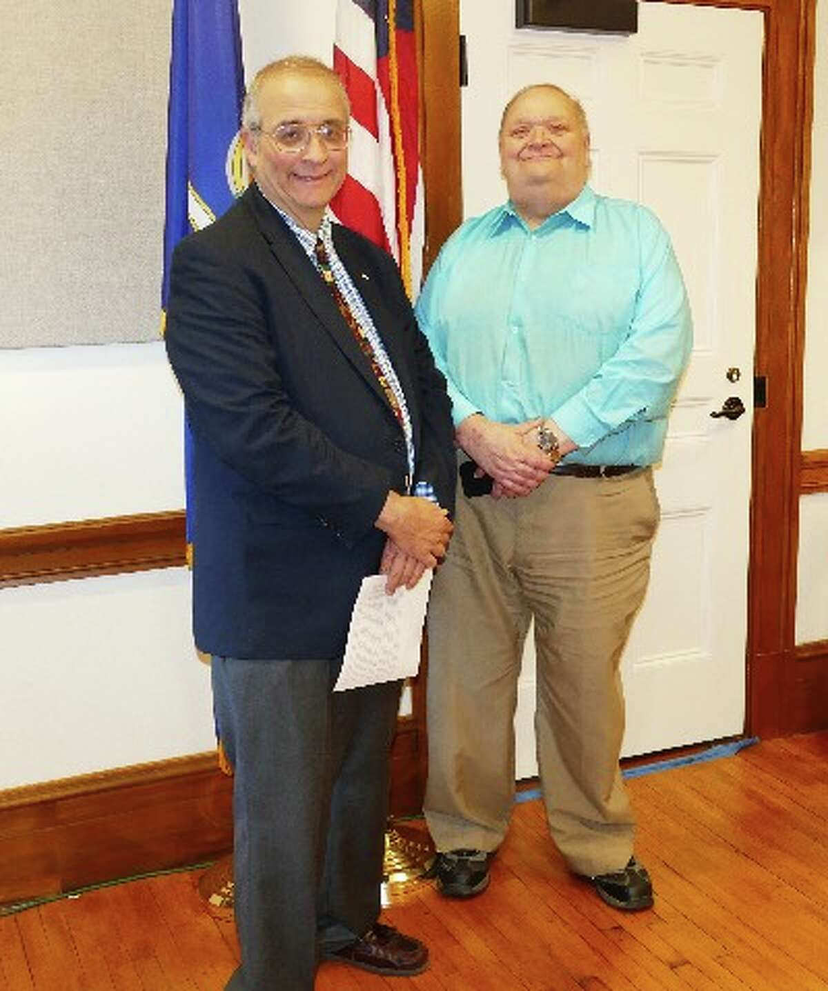 Registrar George Cody, right, with Registrar John Amarilios at the Democratic Town Committee Caucus May 23 where Amarilios was nominated and endorsed to be the Democrat candidate for registrar. - Greg Reilly photo