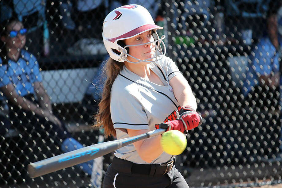 New Canaan's Adriana Annese raps out a hit during the Rams' 8-4 win over Wilton on Monday. — Terry Dinan photo