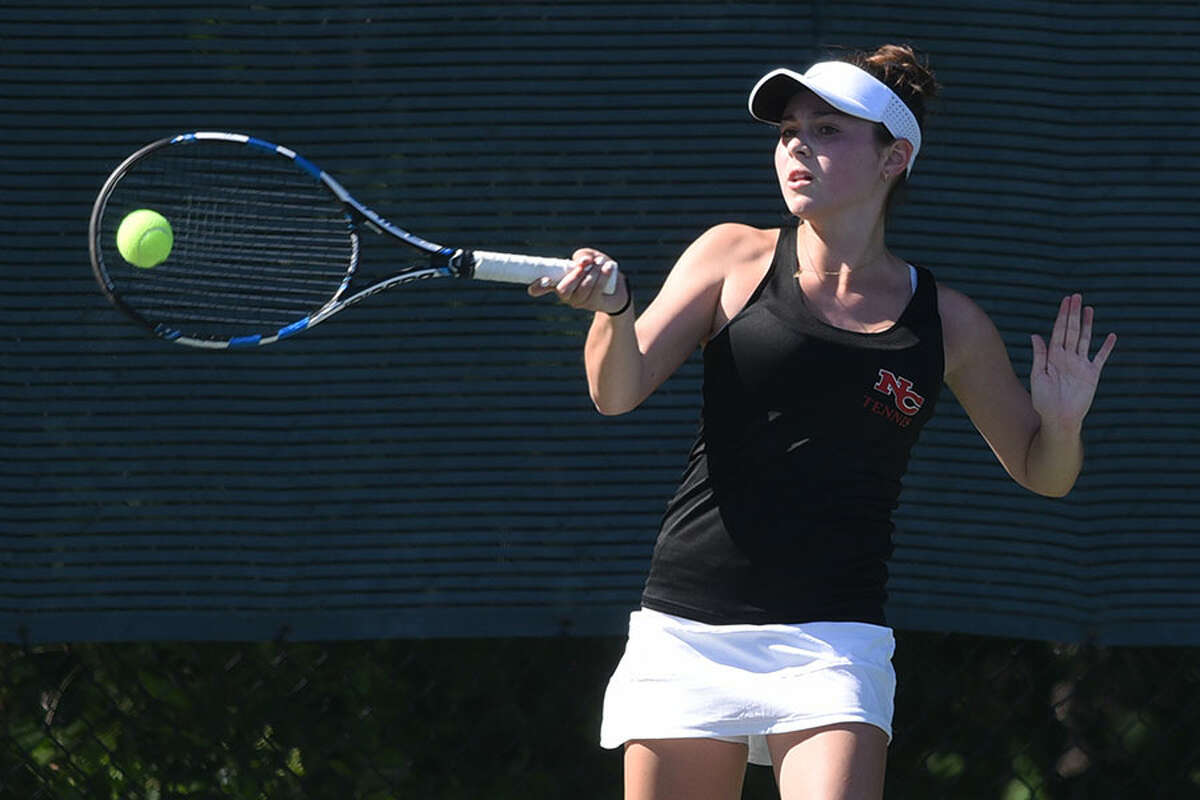 New Canaan's Maddy Wilson returns a shot during the FCIAC girls tennis semifinals Monday at Darien HS. - Dave Stewart photo