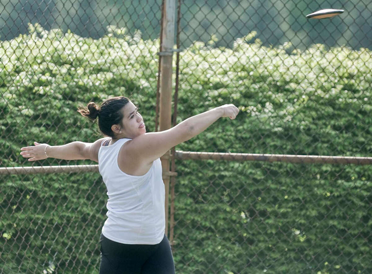 New Canaan's Naomi Cimino throws the discus during Monday's girls track and field meet at NCHS. - Scott Mullin photo