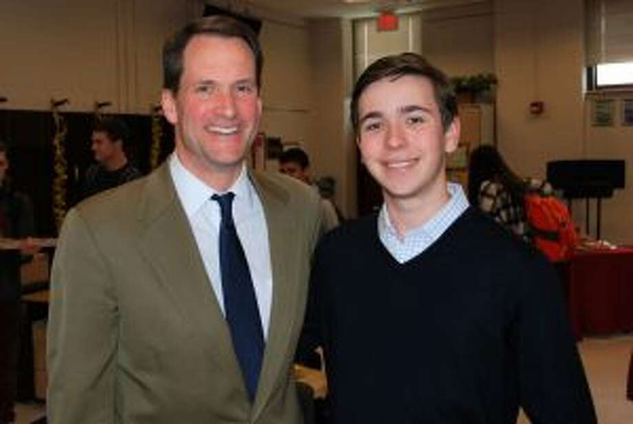 Congressman Jim Himes recently spoke at New Canaan High School. U.S. Rep. Jim Himes visits with New Canaan High School's Current Events Cafe founder Griffin Fill on April 30 at the school. — Contributed photo