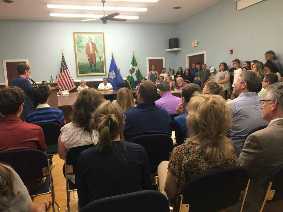 The crowd filled the New Milford Town Council meeting space and spilled out into the hallway on June 24, 2019. Most spoke in favor of giving schools more money. Photo: /