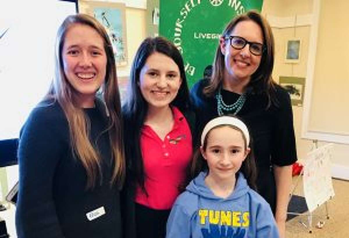 New Canaan: Girls recently learned the importance of advocacy, and the role of government at a LiveGirl leadership summit April 27. Speaker Kate Farrar, the executive director of CWEALF, is shown with LiveGirls, from left, Eliza Pohle, Amelia Wyckoff and Alexandra McManu. - Contributed photo