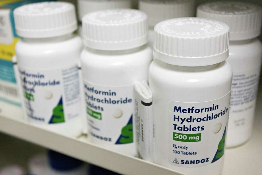 Bottles of a popular diabetes drug, metformin, sit on a pharmacy shelf in Secaucus. Valerie Powell, Pharm.D is the Pharmacy Director and Clinical Pharmacist at Lone Star Family Health Center in Conroe. She reminds that it's important to make plans to bring all of your daily medications with you while traveling. Photo: EMILE WAMSTEKER, STR / NYT / NYTNS
