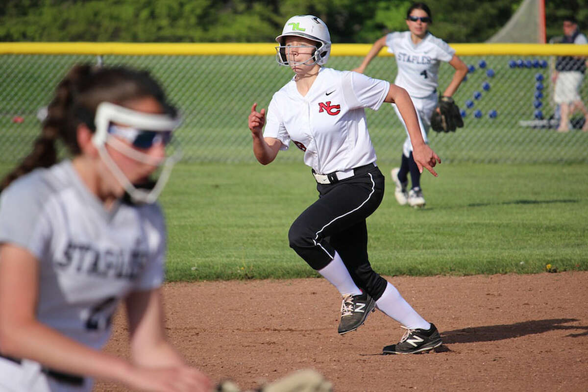 New Canaan's Hannah Moore on the basepaths during the Rams' 5-0 victory over Staples Monday night in Westport. - Terry Dinan photo