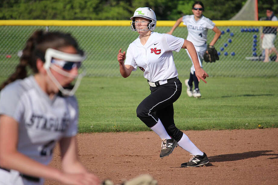 New Canaan's Hannah Moore on the basepaths during the Rams' 5-0 victory over Staples Monday night in Westport. — Terry Dinan photo