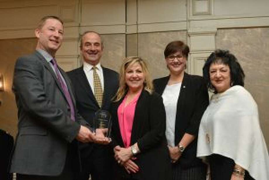 Bankwell, which has two locations in New Canaan, has received the Top Customer Service award. From left, George Chateauneuf of the Warren Group presents the award to Bankwell CEO Chris Gruseke, Assistant Branch Manager Lori Masella, Branch Manager Lisa Cole and Assistant Branch Manager Flo Carbone.— Contributed photo