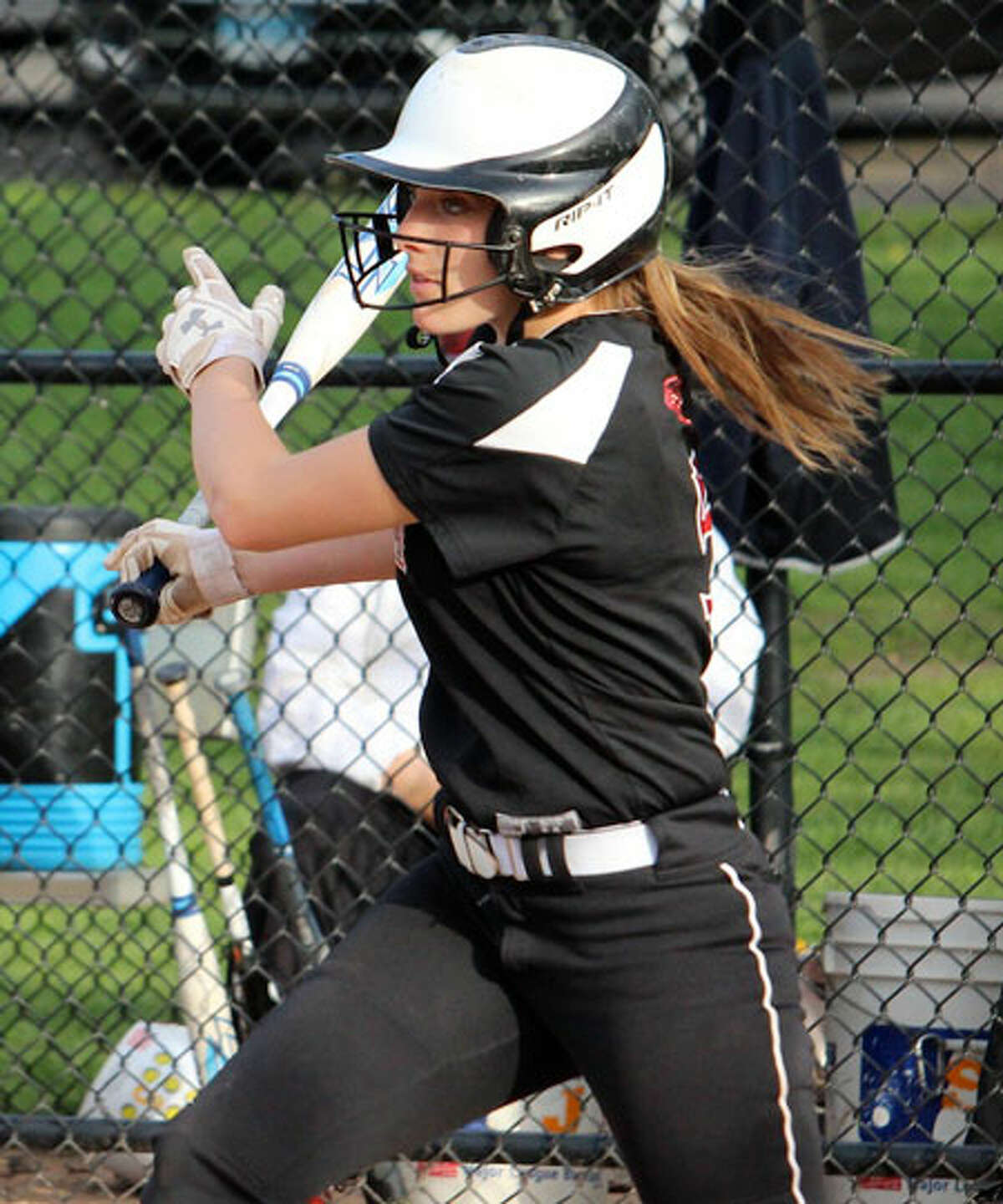 Gillian Kane raps out a hit during Friday's game in Waveny Park. - Terry Dinan photo