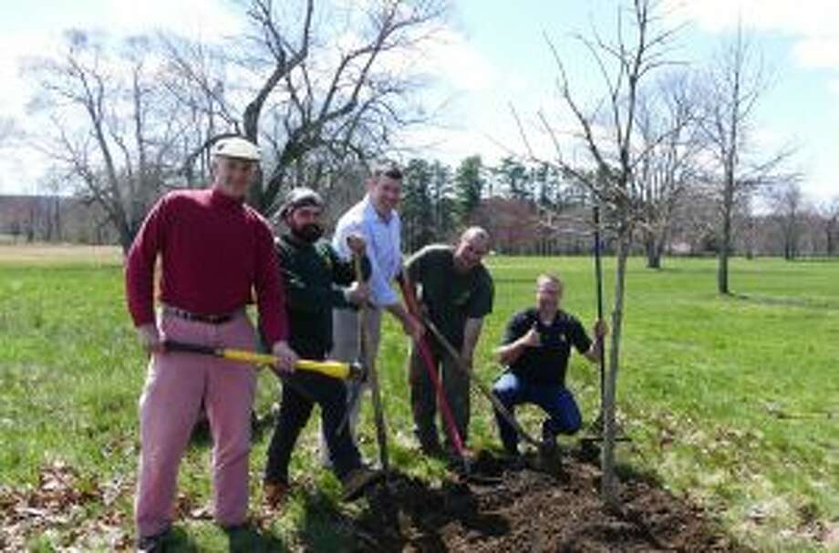 Celebrating planting a tree that was donated to the town by Almstead Tree Co., in Waveny Park are Chris Schipper of Waveny Park Conservancy; Chad Yvon of Almstead; Brock Saxe of Waveny Park Conservancy; Erik Valenzuela of Almstead and Isaac Taylor of Almstead giving a thumbs up. — Grace Duffield photo