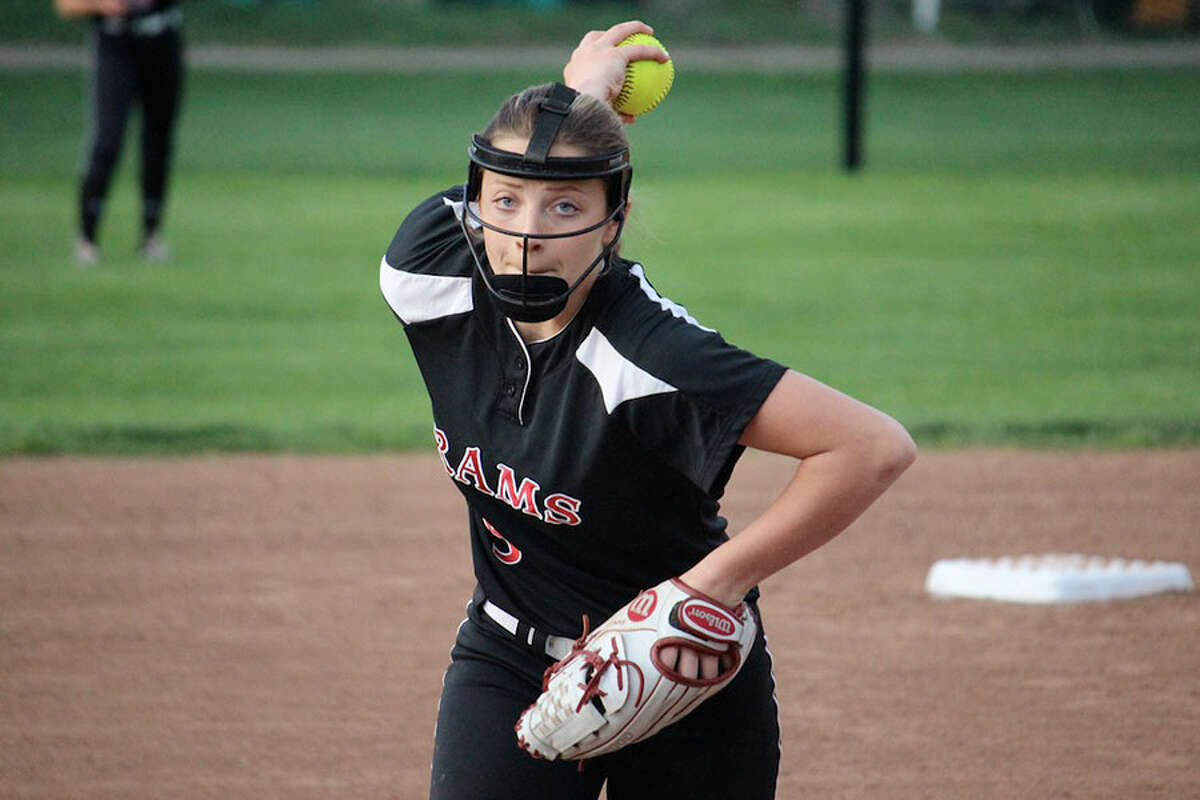 New Canaan senior Gillian Kane winds up for a pitch during the Rams' 2-1 win over Darien Monday in Waveny Park.