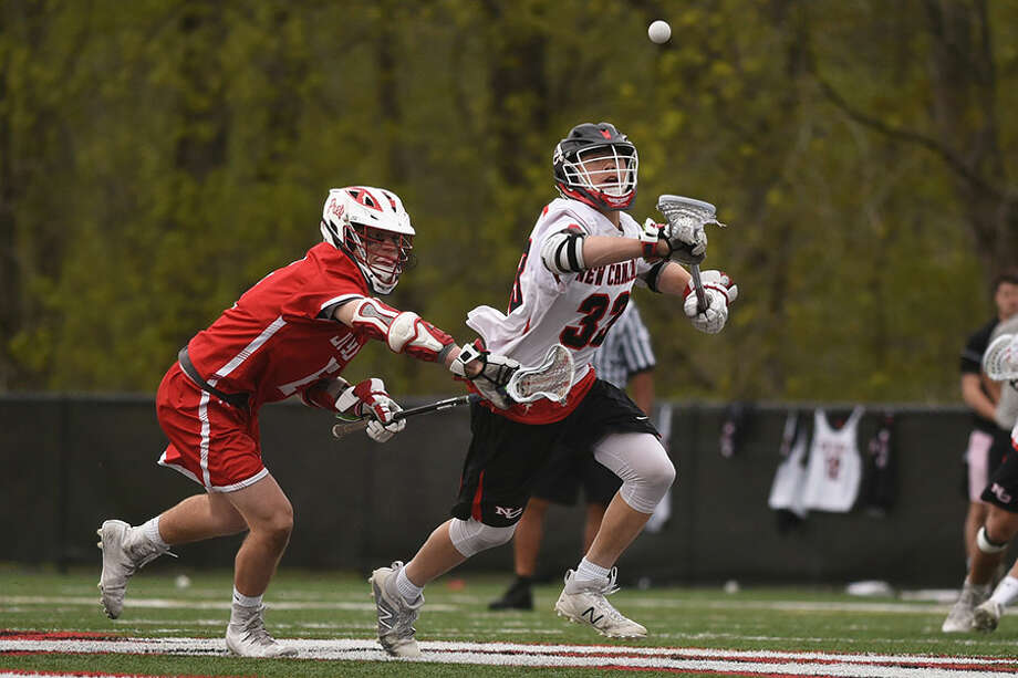 New Canaan's Justin Wietfeldt wins a faceoff during a boys lacrosse game between New Canaan and Fairfield Prep on May 5 at Dunning Field. — Dave Stewart photo