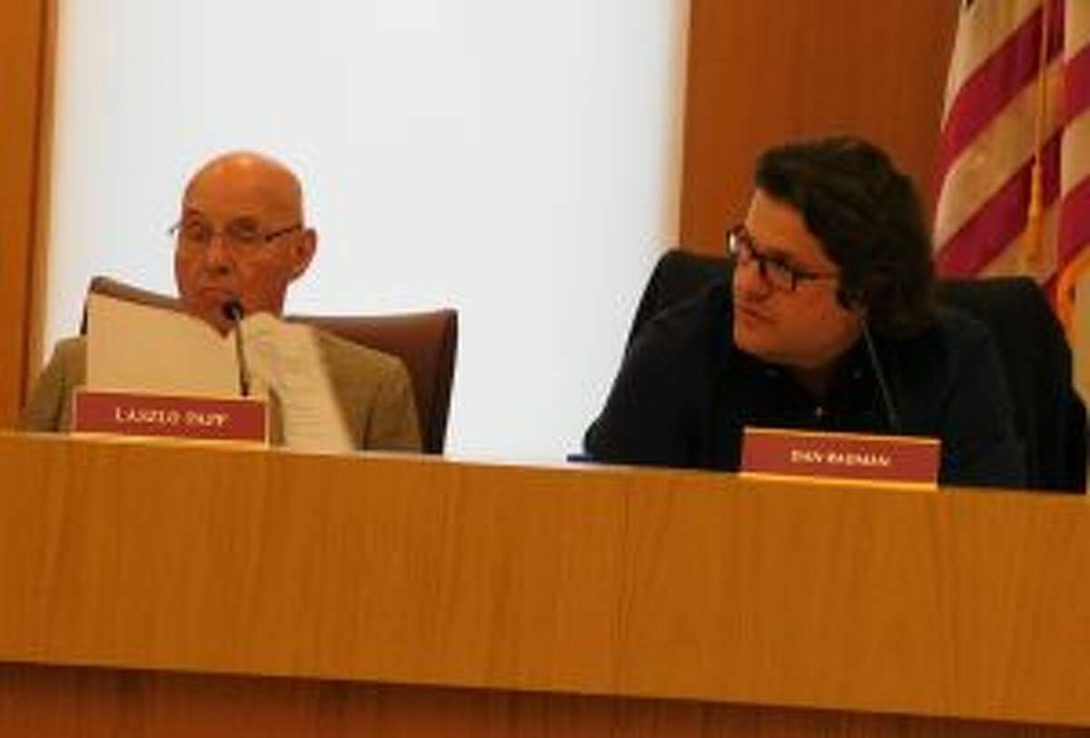 Medical Marijuana sales are banned from the town of New Canaan. P&Z member Dan Radman, right, makes a point while member Laszlo Papp listens during the commission's April 24 meeting. - Brad Durrell photo