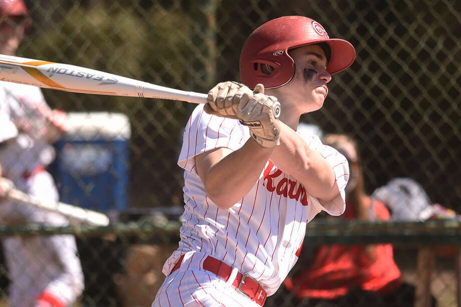 New Canaan senior co-captain Griffin Arnone follows through on a hit during a game in Mead Park. The Rams won three of their last four games to move to 4-4 heading into play Wednesday. — Dave Stewart photo