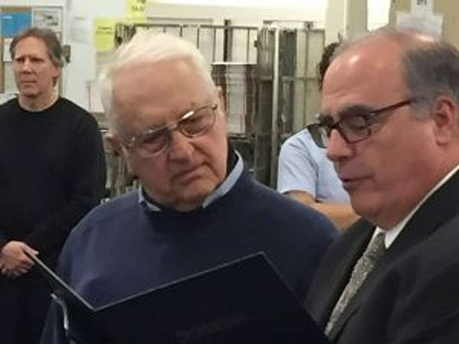 A New Canaan Town letter carrier is marking his 60th year with the United States Postal Service. Connecticut Valley District Manager David Mastroianni Jr. and Anthony Spadaccini are shown at the April 23 celebration. — Contributed photo