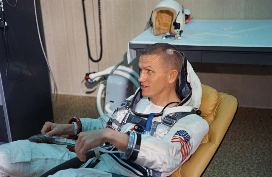 Astronaut Frank Borman, command pilot of the National Aeronautics and Space Administration's (NASA) Gemini-7 spaceflight, undergoes suiting up operations in the Launch Complex 16 suiting trailer. A medical biosenser is attached to his scalp Dec. 4, 1965. (NASA)