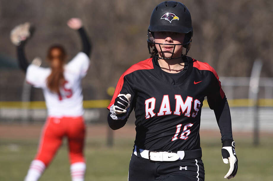 New Canaan's Kaitlyn Fico (16) rounds the bases on a double by Ava Biasotti during a softball game against Greenwich in Waveny Park on Monday, April 1. — Dave Stewart/Hearst Connecticut Media / Hearst Connecticut Media