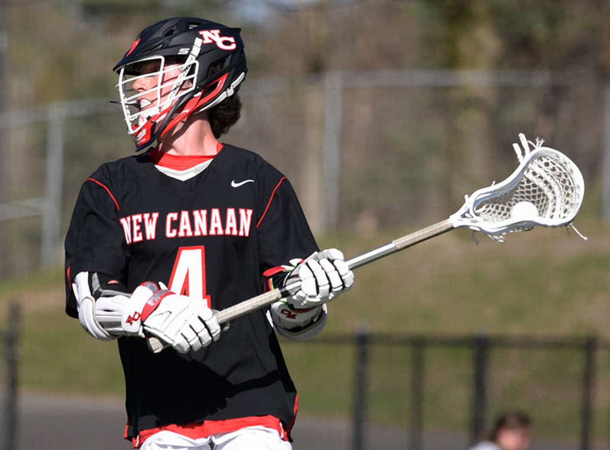 Scenes from New Canaan's 13-8 win over Greenwich in boys lacrosse on April 26. - Dave Stewart photo
