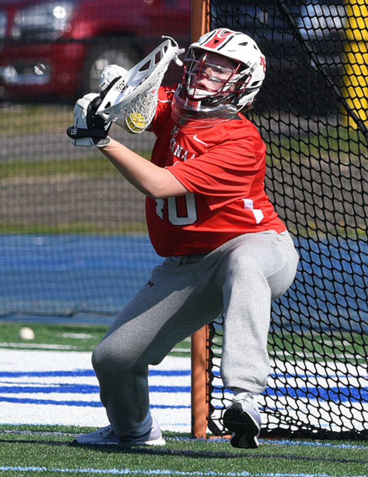 New Canaan goalie Caroline O'Dea makes one of her eight saves against the Blue Wave attack. - Dave Stewart photo