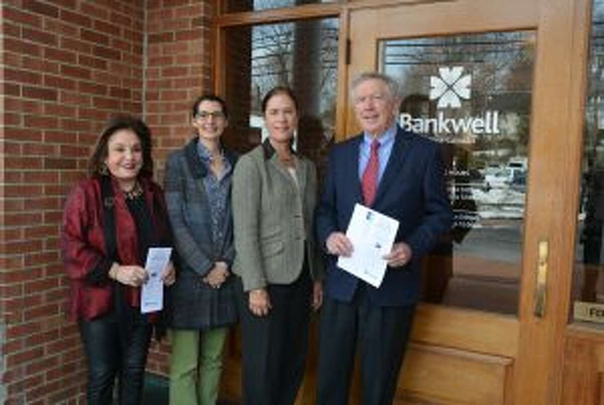 New Canaan: The League's Know Your Reps guide is in the mail. From left, Janet Davis, League of Women Voters of New Canaan; Micaela Porta, president of LWVNC; Heidi DeWyngaert, executive vice president and chief lending officer, Bankwell; Kevin Moynihan, First Selectman of New Canaan. - Contributed photo