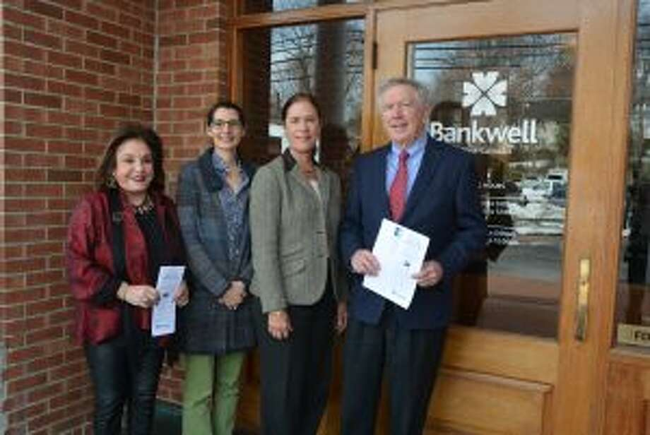 New Canaan: The League's Know Your Reps guide is in the mail. From left, Janet Davis, League of Women Voters of New Canaan; Micaela Porta, president of LWVNC; Heidi DeWyngaert, executive vice president and chief lending officer, Bankwell; Kevin Moynihan, First Selectman of New Canaan. — Contributed photo