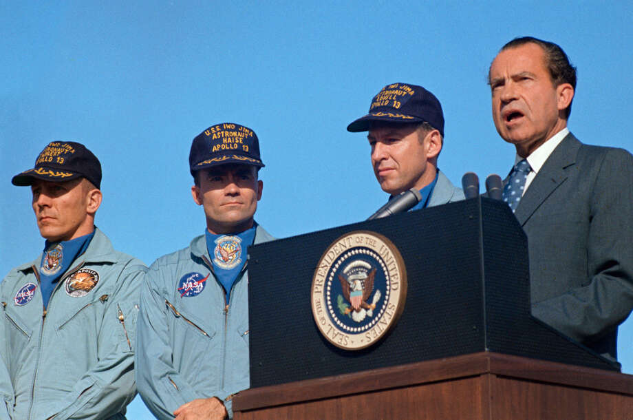 President Richard M. Nixon speaks at Hickham Air Force Base prior to presenting the nation's highest civilian award to the Apollo 13 crew. Receiving the Presidential Medal of Freedom were astronauts James A. Lovell Jr., (next to the Chief Executive), commander; John L. Swigert Jr. (left), command module pilot; and Fred W. Haise Jr., lunar module pilot. Wives of Lovell and Haise and the parents of Swigert accompanied the President to Hawaii. The Apollo 13 splashdown occurred at 12:07:44 p.m. (CST), April 17, 1970, about a day and a half prior to the Hickam Air Force Base ceremonies April 19. 1970. (NASA)