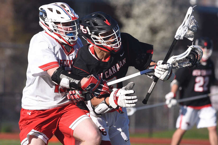 New Canaan's Owen Shin and Greenwich's Luke Blaine clash during New Canaan's 13-8 win on Thursday at GHS. — Dave Stewart photo