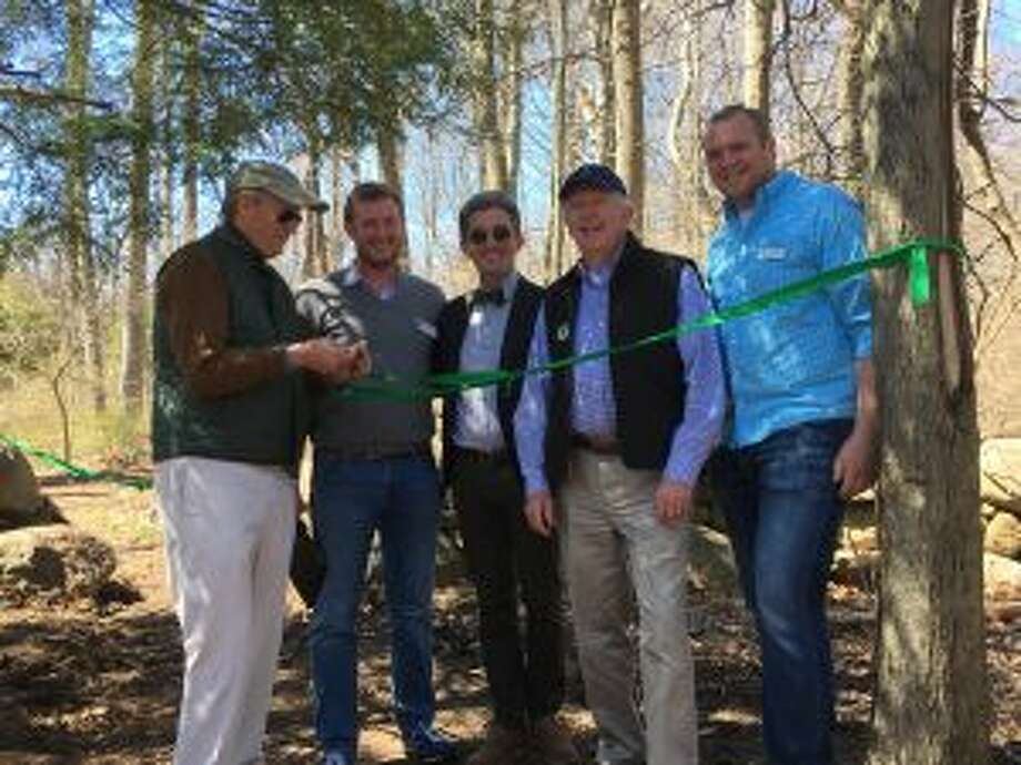 As New Canaan Land Trust board President Art Berry, far left, was cutting the ribbon on the new section of GreenLink trail Sunday, standing by from left were Land Trust Executive Director Aaron Lefland, Town Council Chairman John Engel, First Selectman Kevin Moynihan, and New Canaan Nature Center Executive Director Bill Flynn. — Greg Reilly photo. Groups recently joined forces, and linked Irwin Park to the New Canaan Nature Center.
