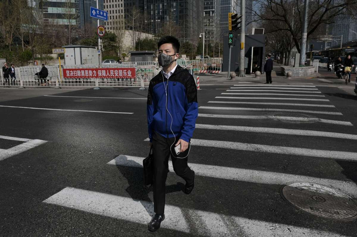 A man wears a protective mask to reduce the effects of air pollution in Beijing, March 2019.