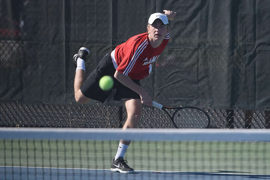 New Canaan co-captain Luke Crowley follows through on a serve. — Dave Stewart photo