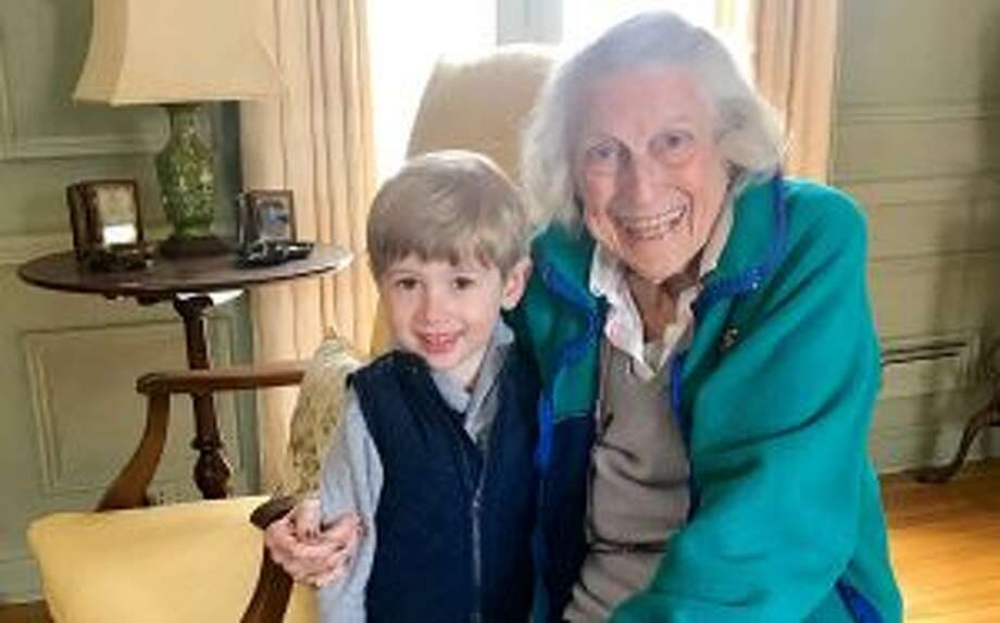 New Canaan: Volunteers are important, and meaningful to the community. The Little Rams, children of members of the Young Women's League, helped 60 Staying Put members get a jump on spring by delivering potted plants and cheer.  Here, Hunter Morgan visits with Mimi McMennamin.