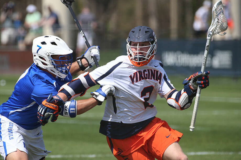Michael Kraus of the University of Virginia works with the ball during a game last season. — Matt Riley/UVA Media Relations photo