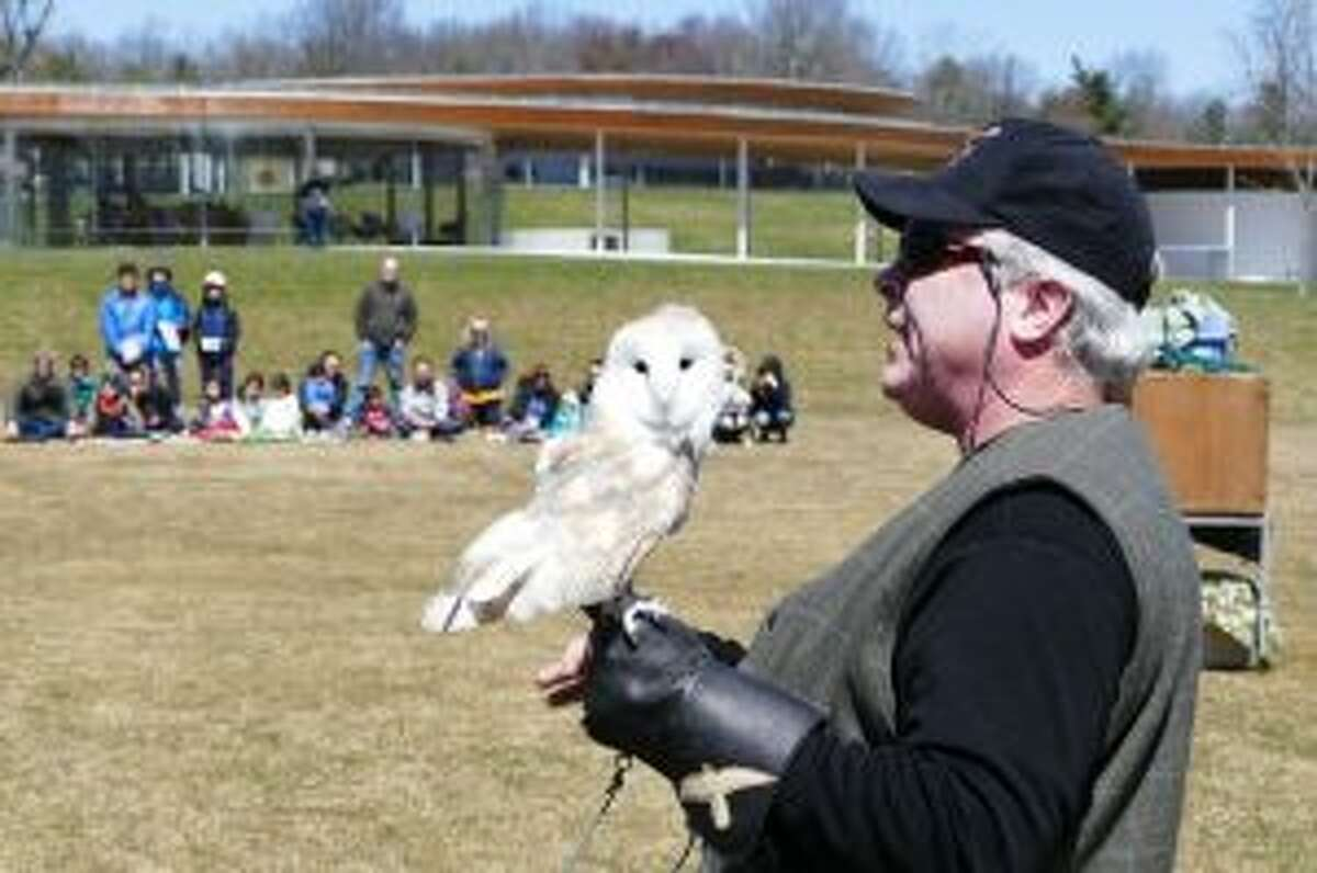 A barn owl and Bryan Bradley. Owls can turn their heads 270 degrees because they have extra vertebrae in their necks. Grace Duffield photo