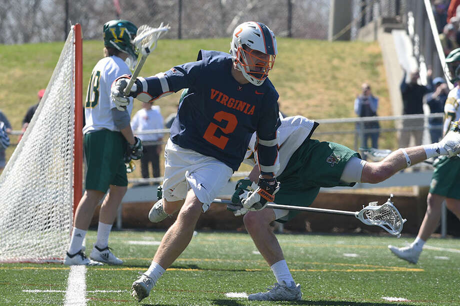 New Canaan's Michael Kraus, a sophomore with the Virginia Cavaliers, celebrates his go-ahead goal with 1:47 remaining in Saturday's Div. I men's lacrosse game at Dunning Field. Virginia defeated Vermont, 10-9. — Dave Stewart photo