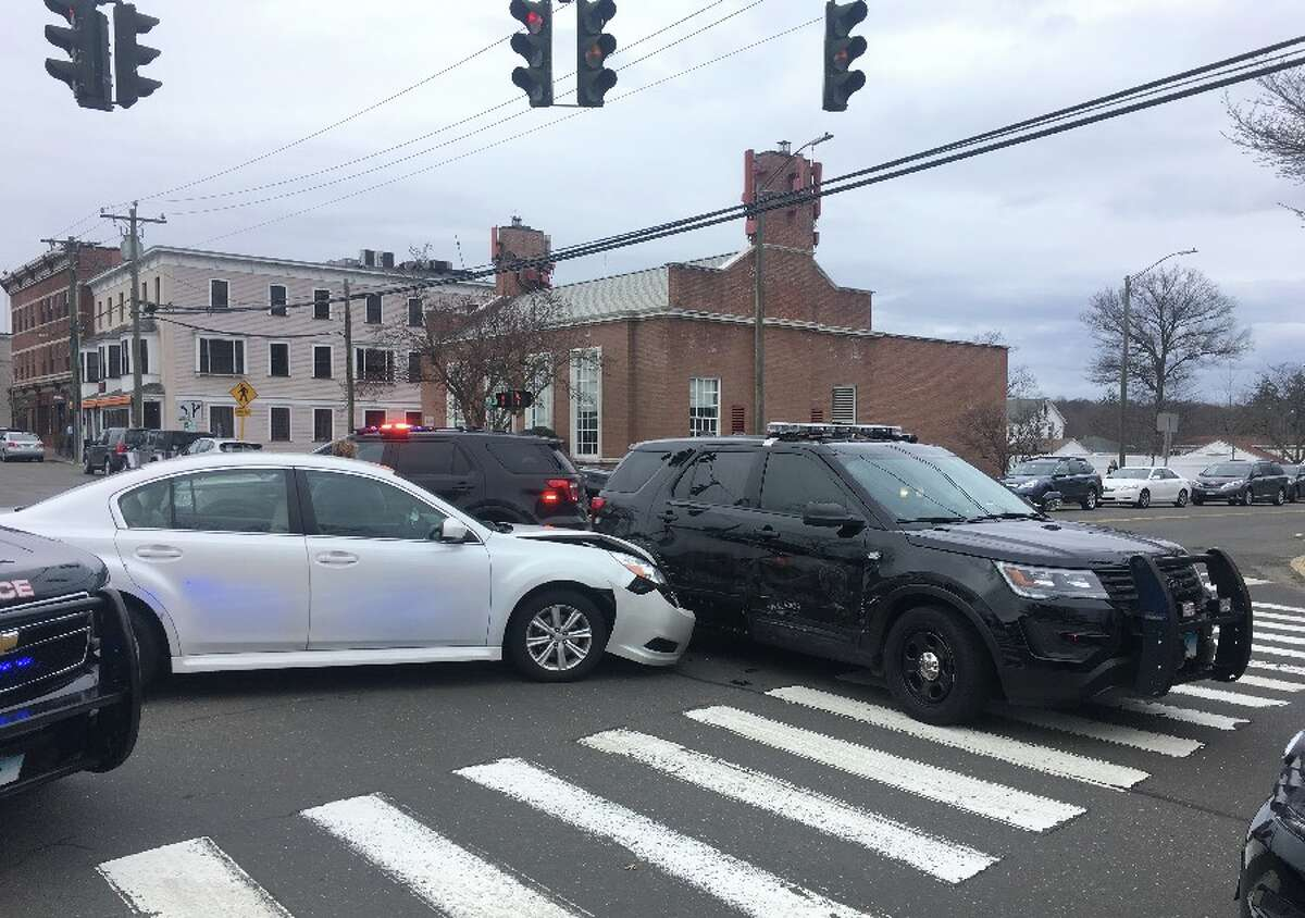 The accident scene Tuesday late afternoon at the intersection of Main and Cherry streets. - Greg Reilly photo