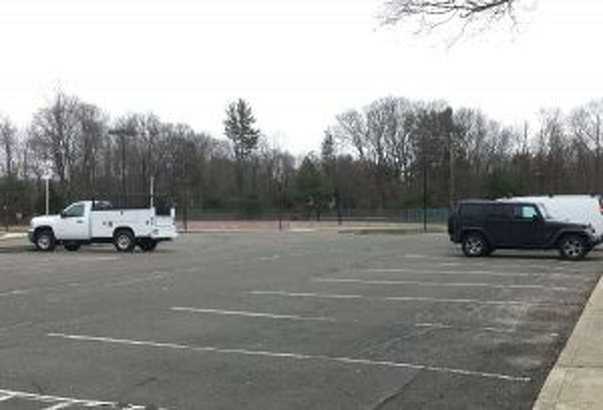 At the same time that cars filled illegal parking spots along South Avenue, this Saxe school parking lot, which is adjacent to the same sports fields, was nearly empty. - Greg Reilly photo
