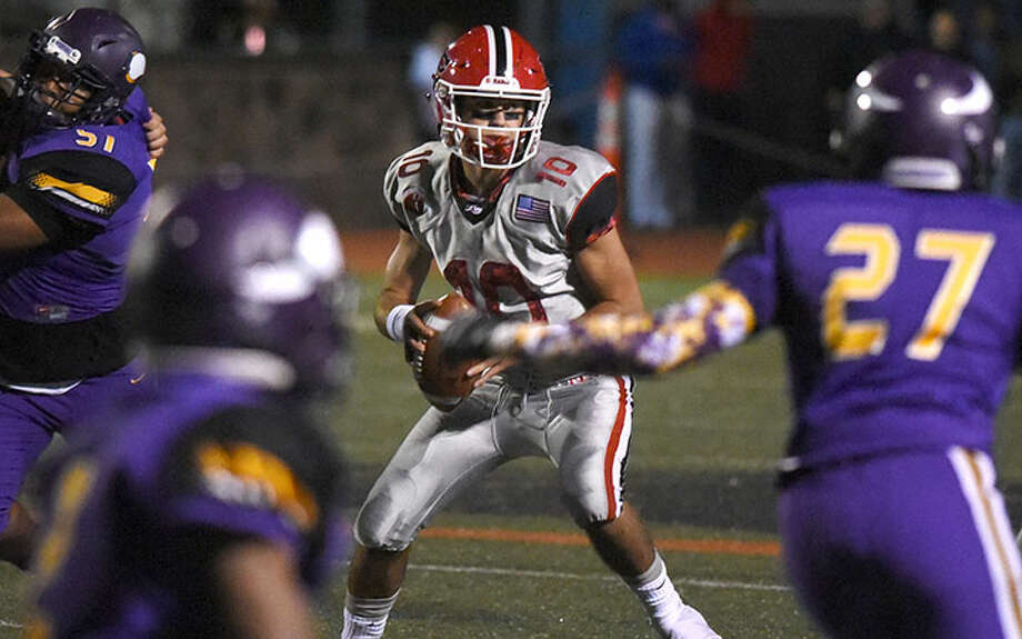New Canaan quarterback Drew Pyne in action during the Rams' win over Westhill last fall. — Dave Stewart photo