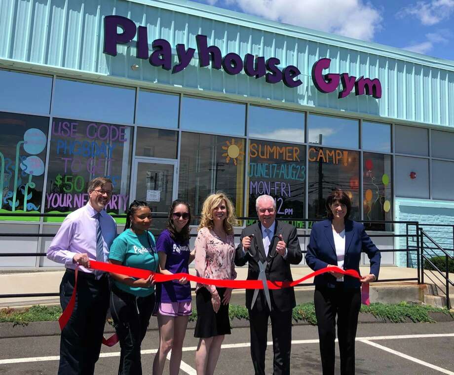 From left, Mark Barnhart (Director of Community and Economic Development), Alexus Richards (Assistant Manager), Amy Craw (Gymnastics Coach), Ardys Persson (Owner), First Selectman Michael Tetreau, Beverly Balaz (President Fairfield Chamber of Commerce). Photo: Contributed Photo