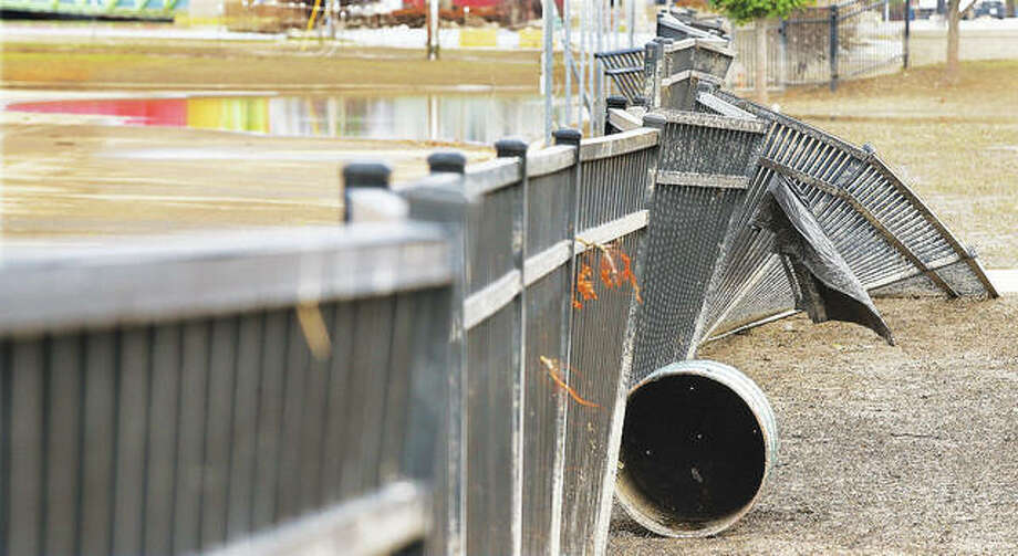 The 3rd Annual BBQ, Bikes and Blues Festival planned for Saturday has been canceled due to damage left by floodwaters to the amphitheater in Riverfront Park, such as this section of metal fencing.