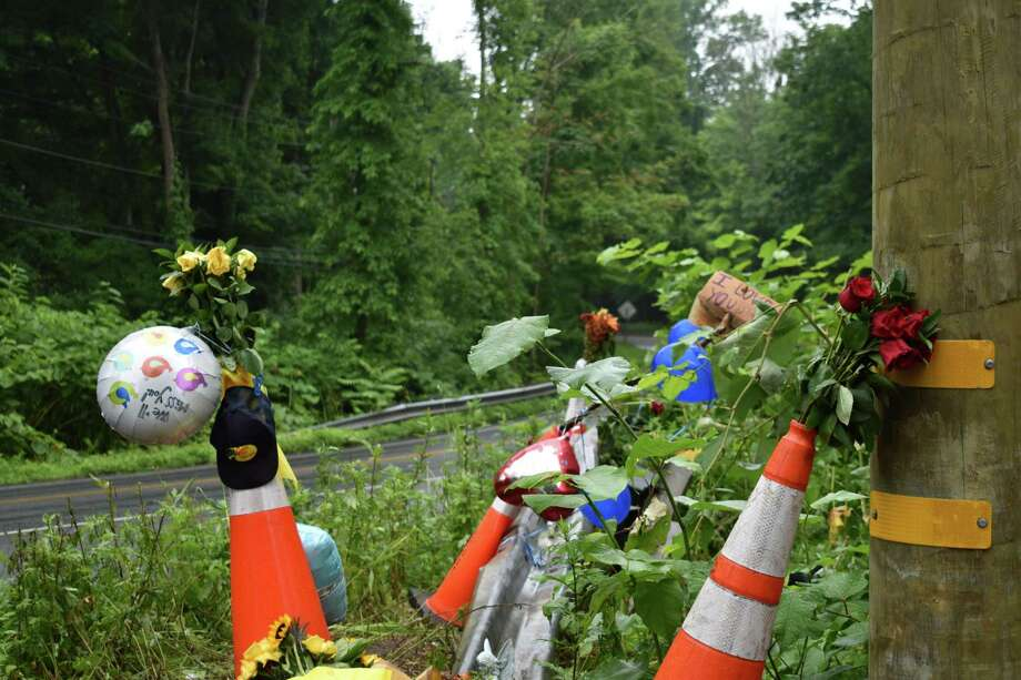 A roadside memorial with balloons, signs, flowers and other gifts at the site of the June 23, 2019, fatal crash on Route 34. Photo: Kendra Baker / Hearst Connecticut Media