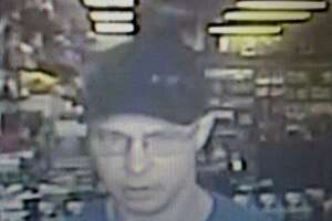 A man is seen in a surveillance photos after authorities say he robbed at Gunpoint a GameStop in Porter.