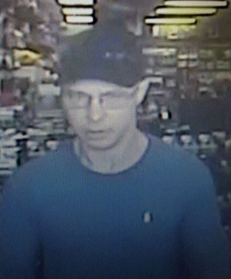 A man is seen in a surveillance photos after authorities say he robbed at Gunpoint a GameStop in Porter. Photo: Courtesy Of The Montgomery County Sheriff's Office
