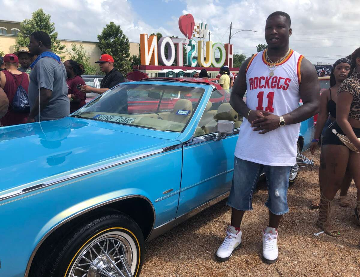 Katy resident Carzavier Mosley shows off his traditional slab made from a 1984 Cadillac El Dorado. At the annual Houston Slab Holiday Car Show & Concert on Sunday, Mosley said the car took him more than three years to build, and he dedicated the slab to his late sister Charlene.