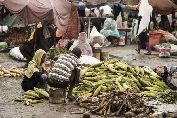 Sellers prepare corn at a market in N'Djamena, Chad, on Tuesday, August 15, 2017.